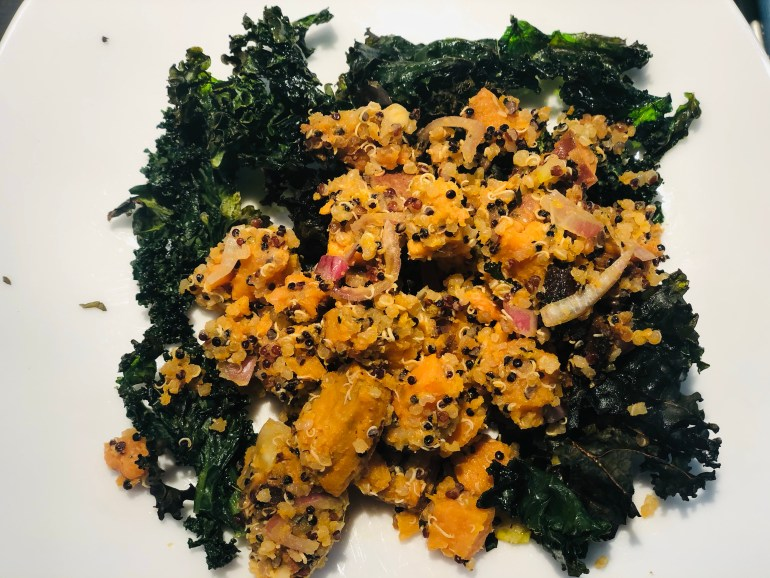 Orange sweet potato salad on a bed of curly greens
