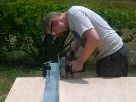 We used a long piece of steel flashing as a circular saw guide. This worked extremely well.