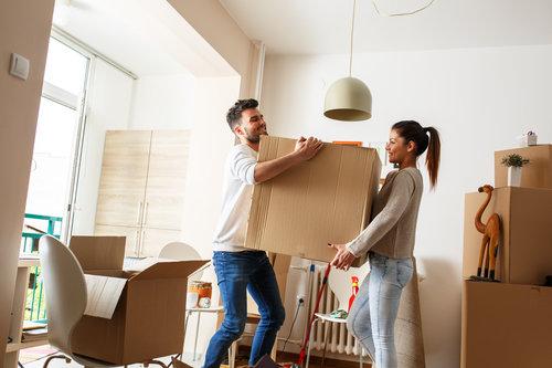 couple moving a box