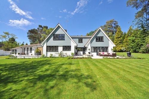 house green lawn blue sky