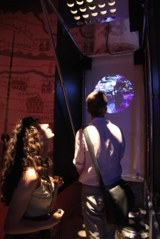 Visitors watching the Space Electronic film.