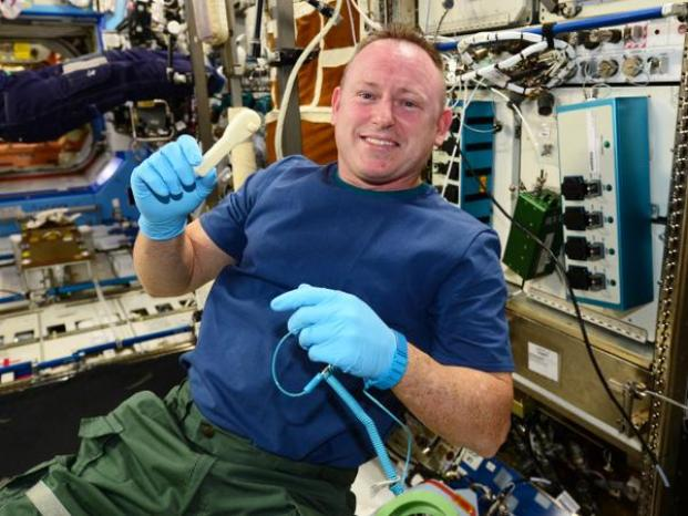 "Astronaut Barry ""Butch"" Wilmore shows off the 3D printed ratchet wrench on the International Space Station. Credit: NASA"