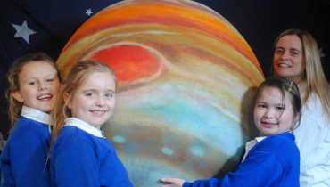 Jo Fox and children from St Peters Primary school in Canterbury with the mighty planet Jupiter