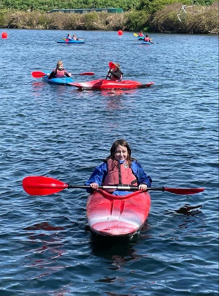 child having fun in canoe