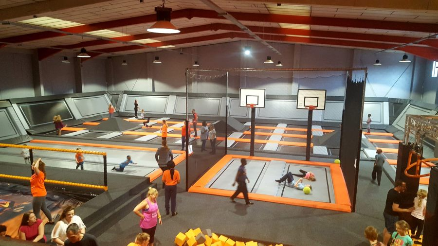 Children and young people trampolining at a trampoline park