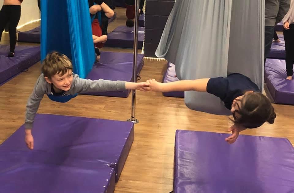 Ariel yoga children holding hands