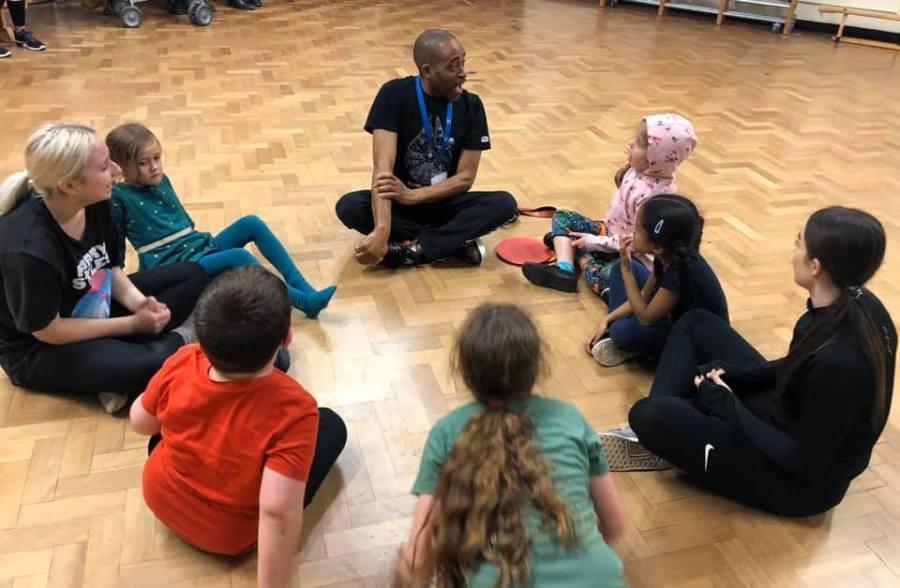 children sitting in circle on floor
