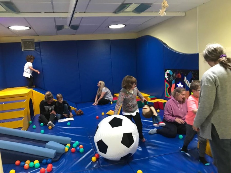 Children playing with giant balls at a softplay