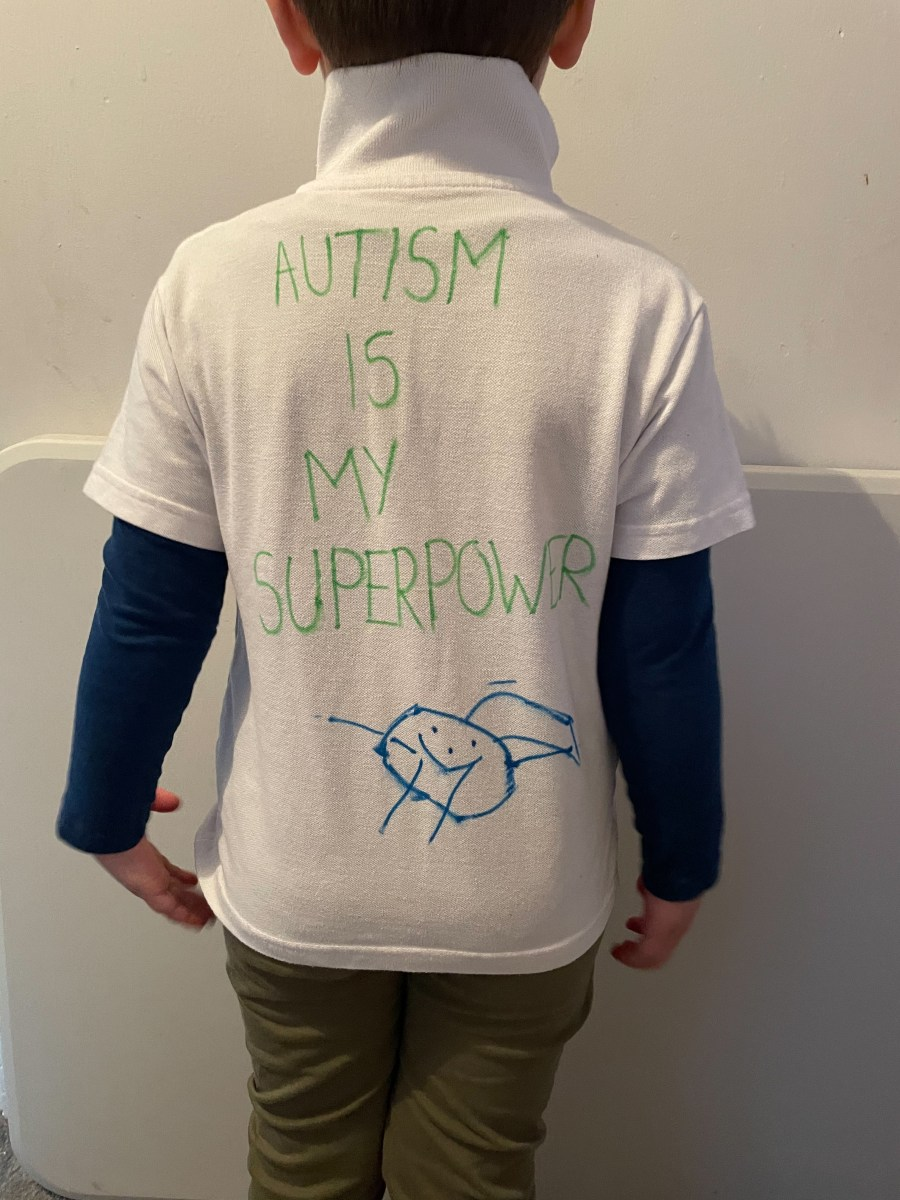 The back of Harley's t-shirt says 'Autism is my Superpower'
