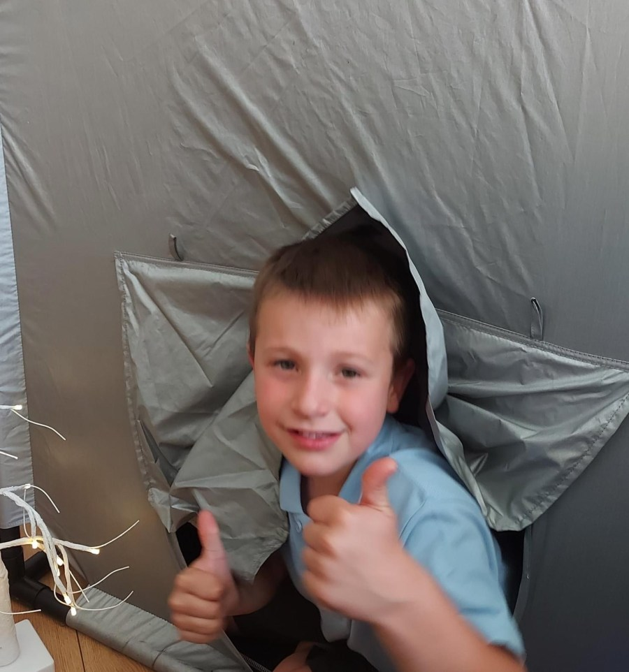 Young boy in a sensory tent that can be borrowed for free from Lending SPACE