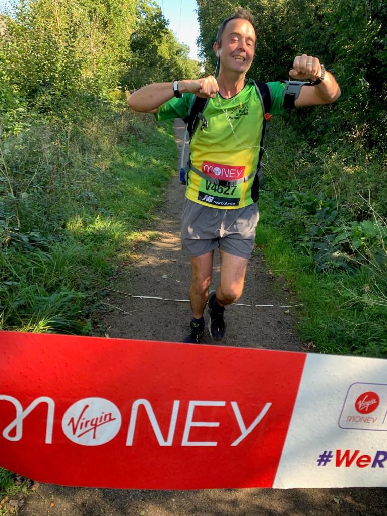 Mark finishing his virtual marathon