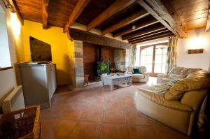 The rustic French charm of the cottages at La Ferme du Cayla. Beams and opulent sofas mix with power showers and beautiful decor