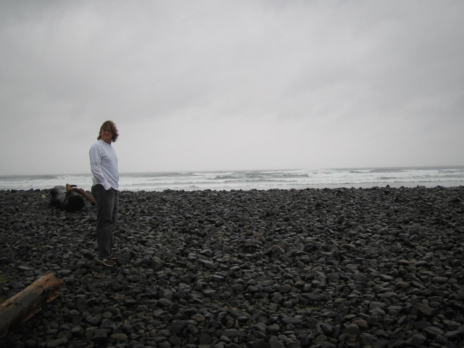 john on a beach on the oregon coast