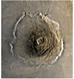 Aerial view ofOlympusMons, a shield volcano on Mars, showing the caldera, escarpment and aureole.