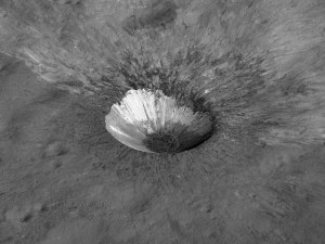 Hell Q crater (the Moon) shows off pristine impact melt that lined the crater walls and pooled in the bottom, now solidified into rock. Ejecta was thrown out several crater radii, and dark impact-melt streamers that formed late in the impact process crossed over the early emplaced ejecta.