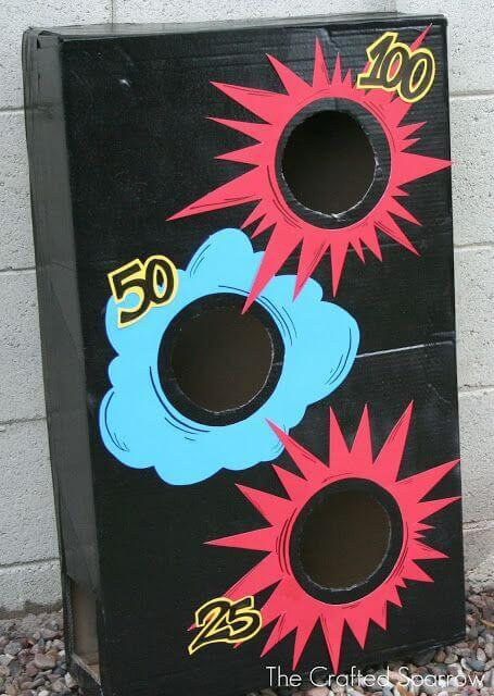 Transform a beanbag toss game with this fun cardboard accessory.