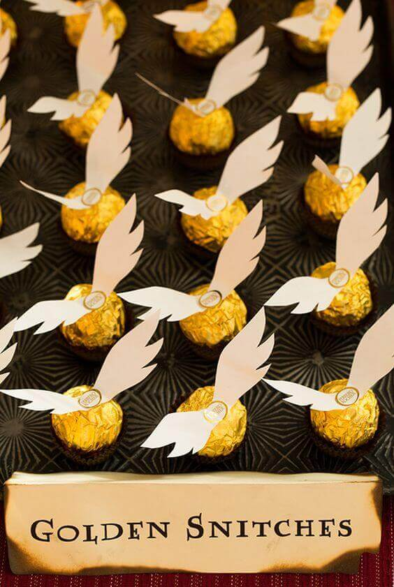 Make simple golden snitches by gluing wings to Ferrero Rocher balls.