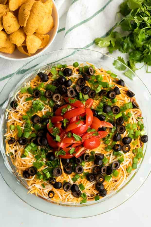overhead shot of seven layer dip on a glass plate