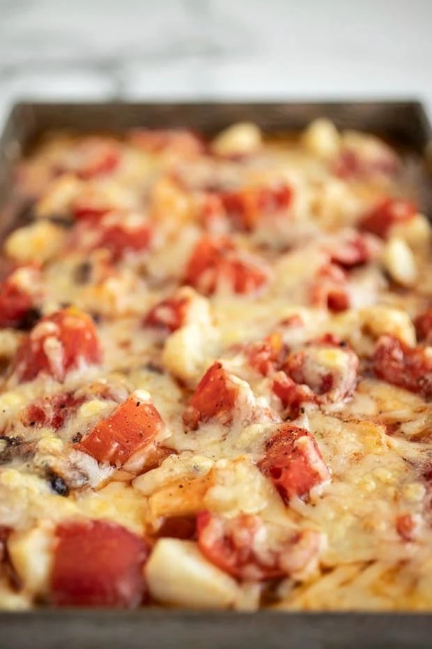 Baking pan with cheese covered beef stew