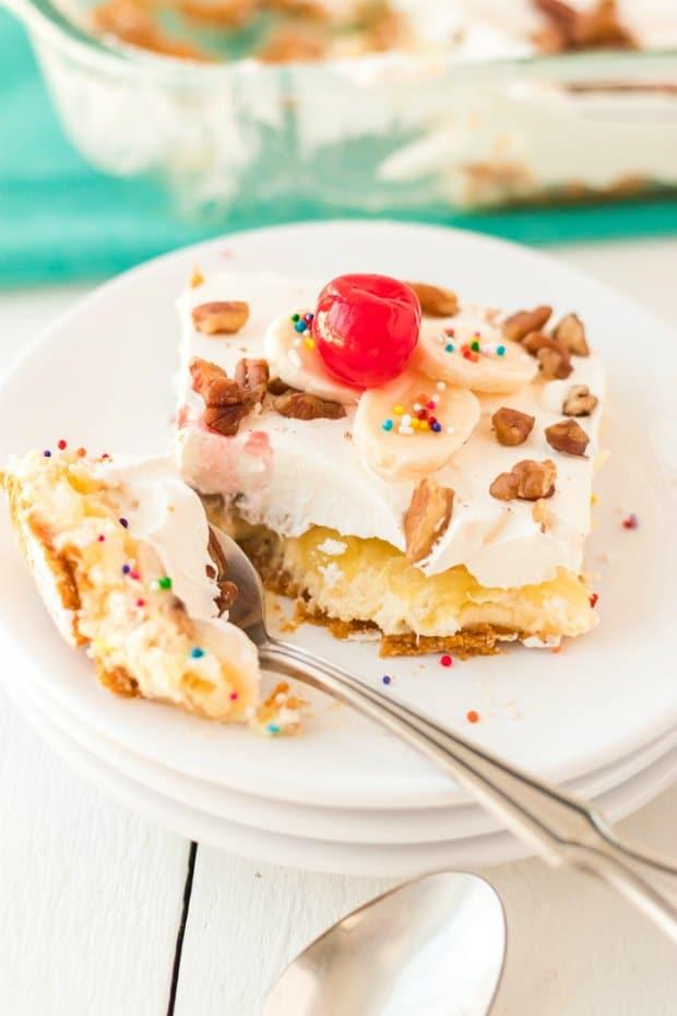slice of banana split cake being eaten