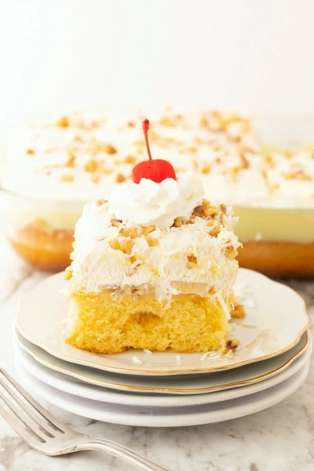 slice of hawaiian wedding cake on white plates