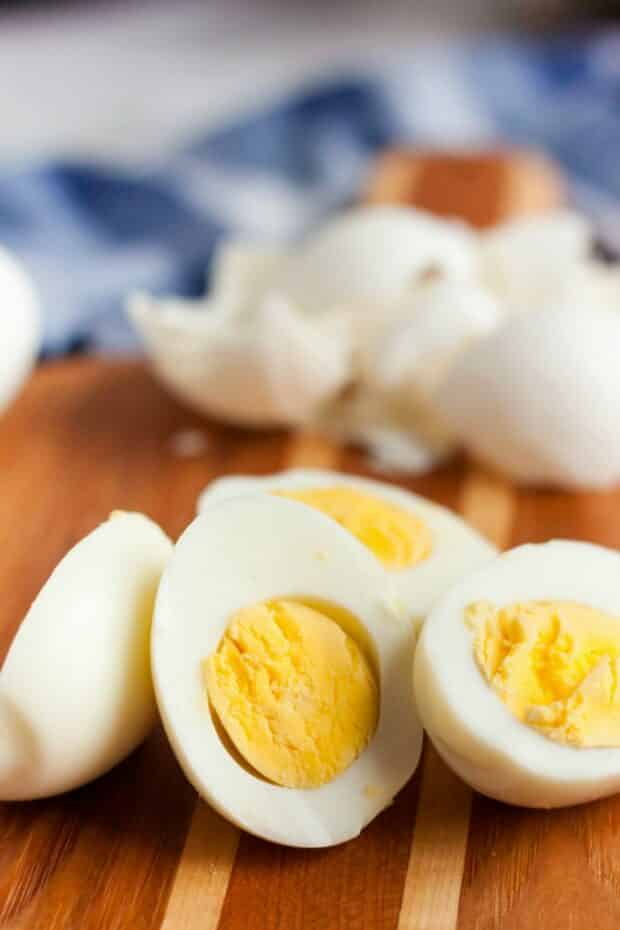 hard boiled eggs cut in half with yolks facing the camera