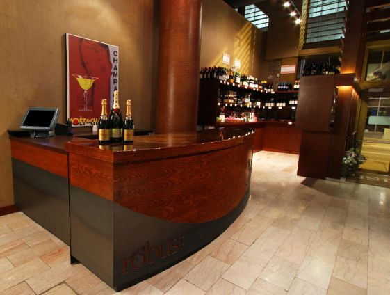 We custom fabricated the cash wrap/host stand next to the retail area.