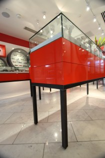 One of the custom display cases we fabricated. Our cabinet vendor made the red laminate, and we assembled it with the steel base we made.