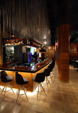 "The gracefully curved bar with ""Rain"" overhead."