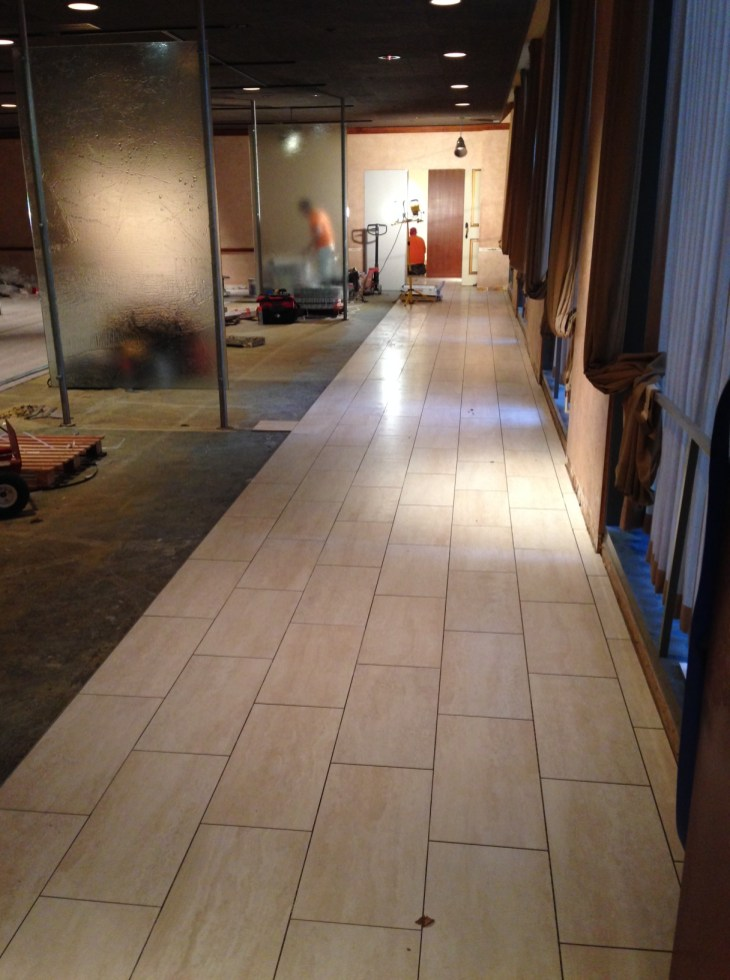 New tile traffic path in the dining room, pre-grout.