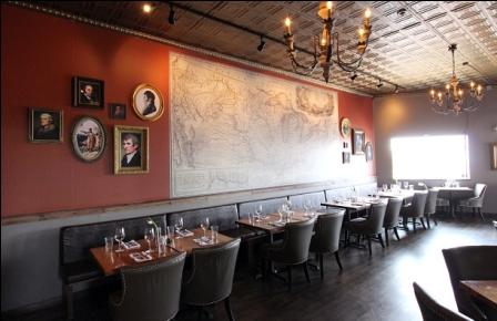 View of the portraits in the Three Flags Tavern dining room with the Karl Bodmer map.