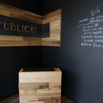 Reception desk and signage. The entire entry has been painted in chalkboard paint.