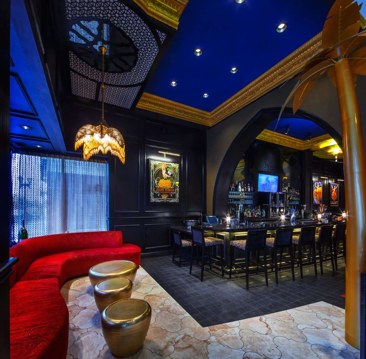Gold palm trees and the sleek bar greet you when you enter the lounge.