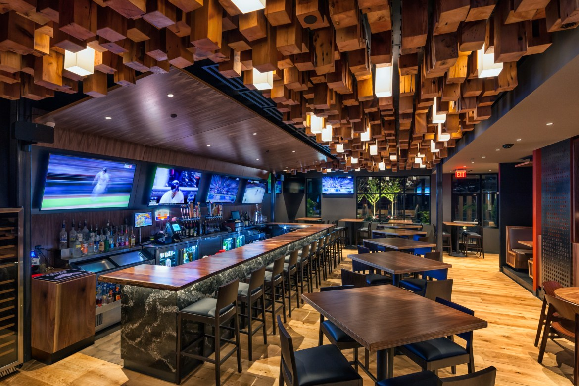 The cedar-timber ceiling with custom lights hangs over the chic bar.