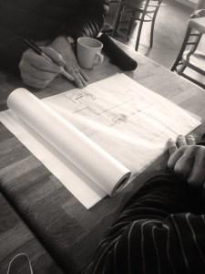 Mike and Tom Niemeier sketching on the Publico floorplan.