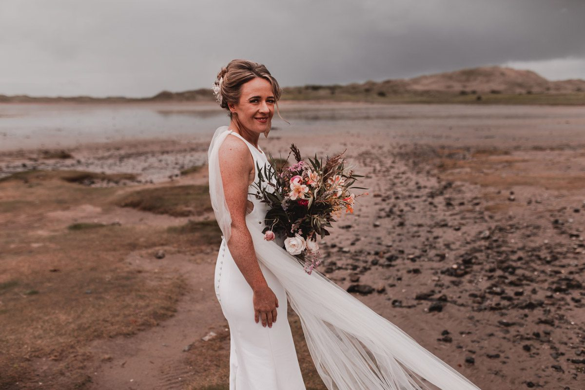 Bride with sustainable & organically grown local wedding flowers