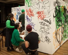 Participants of Tacoma Art Walk at 1120 Creative House were invited to graffiti on walls during St. Patrick's Day event. Photo by Kris Crews.
