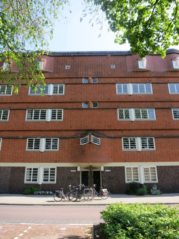 Mid-rise Art Deco apartment buildings line Amsterdam's outer streets