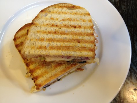 Panini with stuffing, mozzarella cheese, and cranberry sauce