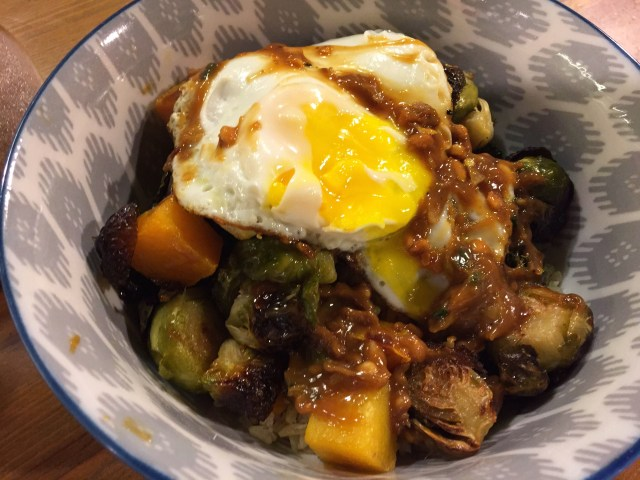 Rice bowl with a fried egg and Yum sauce