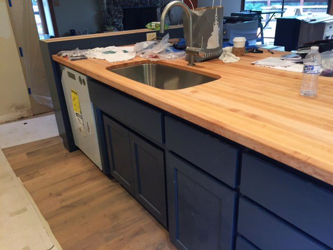 Kitchen sink, faucet and dishwasher