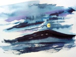 moonrise over a mountain