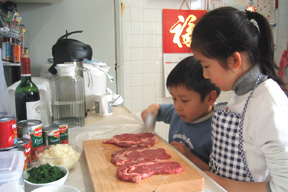 The kids making the Braciole!