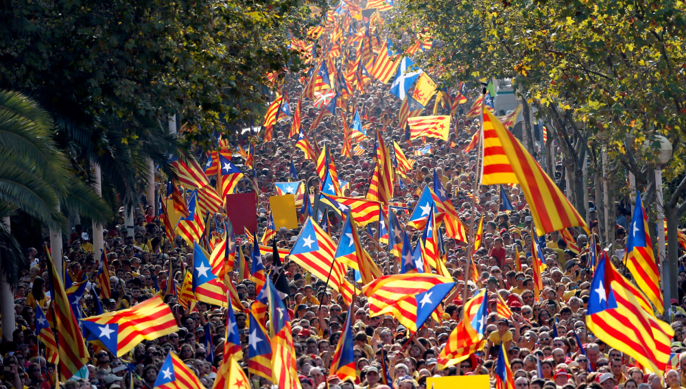 """People hold  Catalan separatist flags known as """"Esteladas"""" during a gathering to mark the Calatalonia day """"Diada"""" in central Barcelona"""