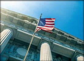 Photo of courthouse exterior and American flag