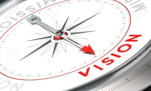 "compass with the word ""vision"""