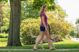 young woman with seeing eye dog