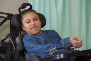 smiling girl in wheelchair