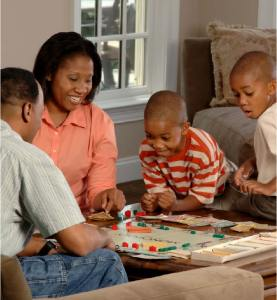 family engaging in board game