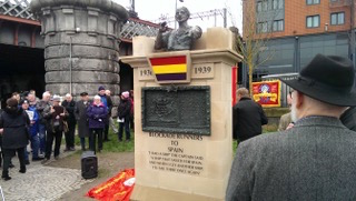The monument 'Blockade-Runners to Spain'. Sculptor Frank Casey with his back to the camera – part of a photo reportage of the unveiling of the monument 'Blockade-Runners to Spain' in Glasgow, 2. March 2019